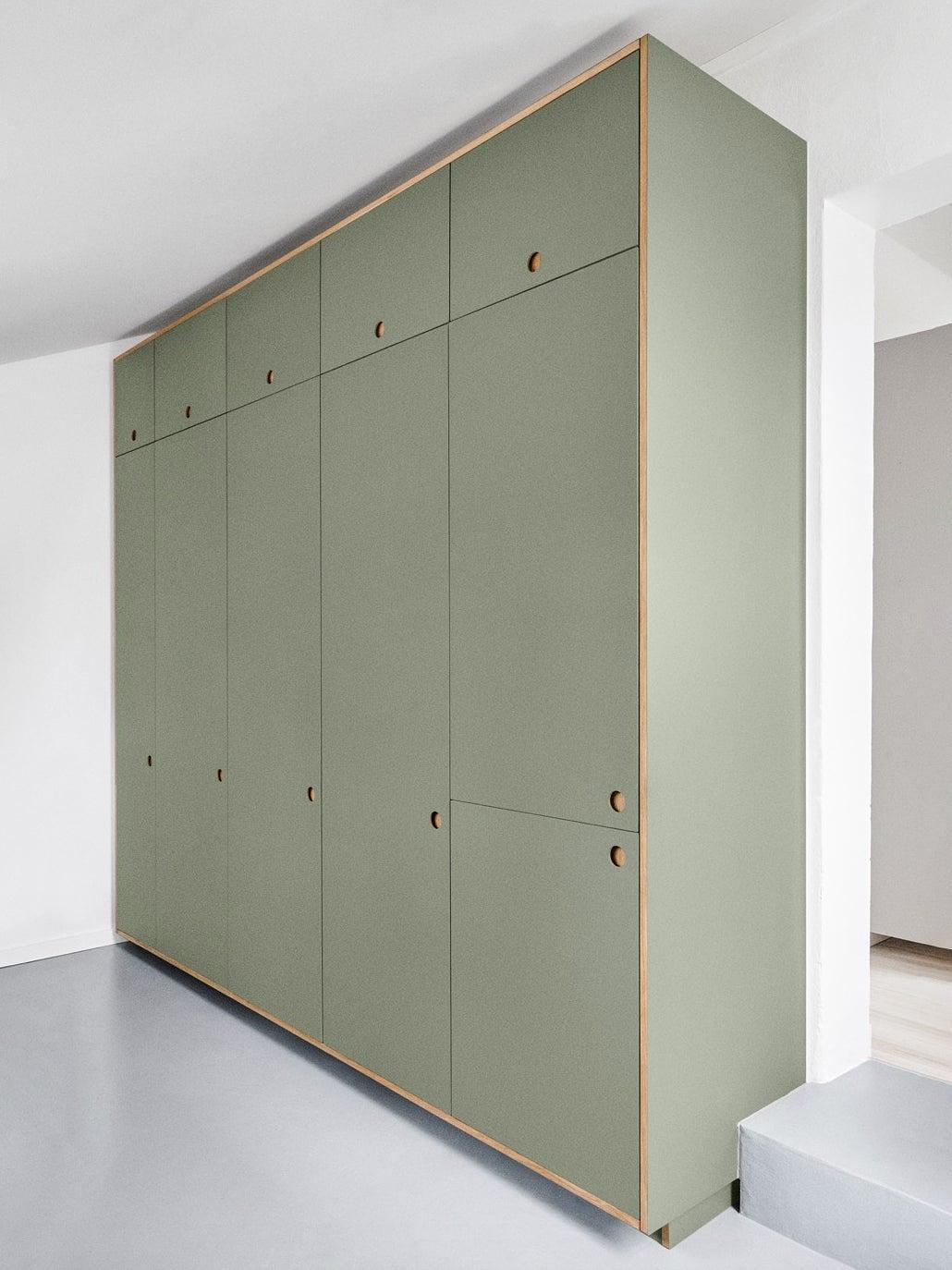 green kitchen tall cupboards