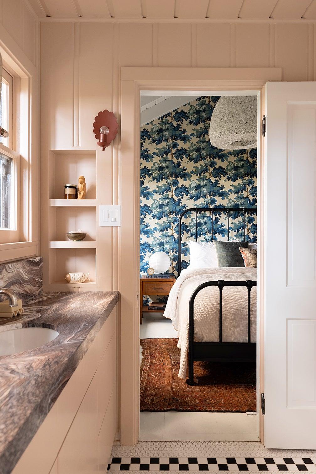 pink bathroom looking into blue bedroom