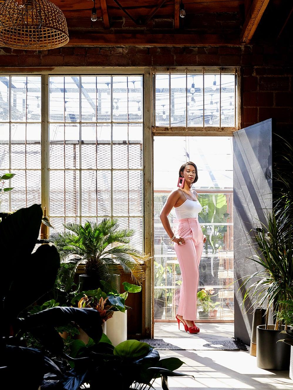 woman in pink jumpsuit in doorway