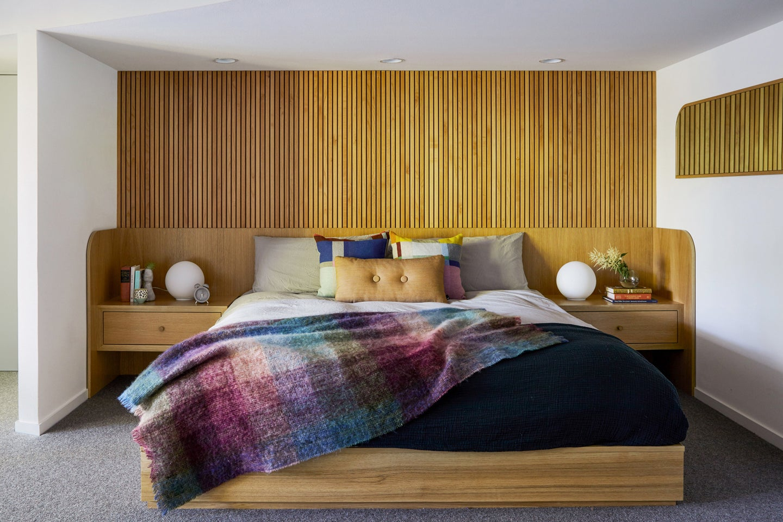 wood slatted built-in bed