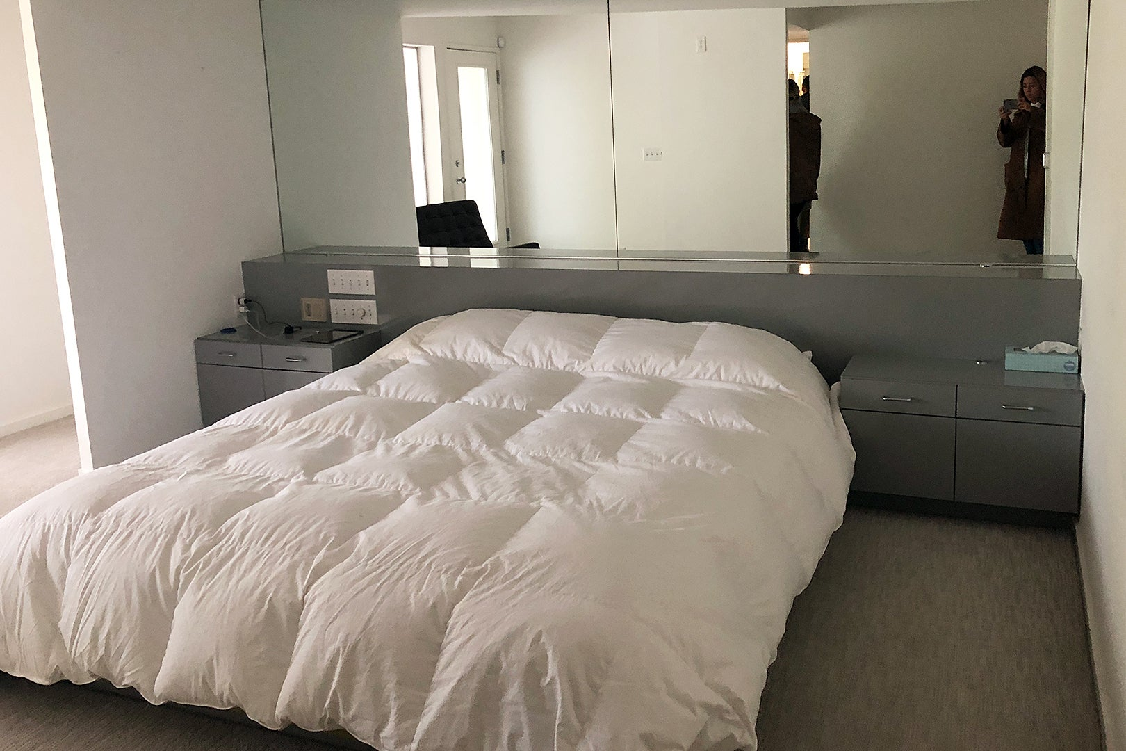 dated bedroom with laminate built-in headboard