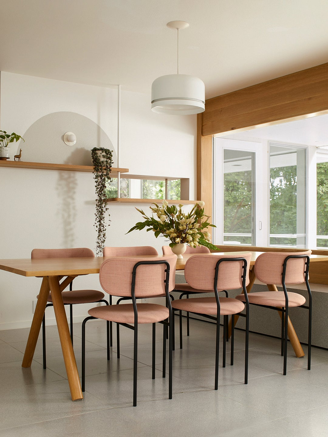 dining room with pink chairs