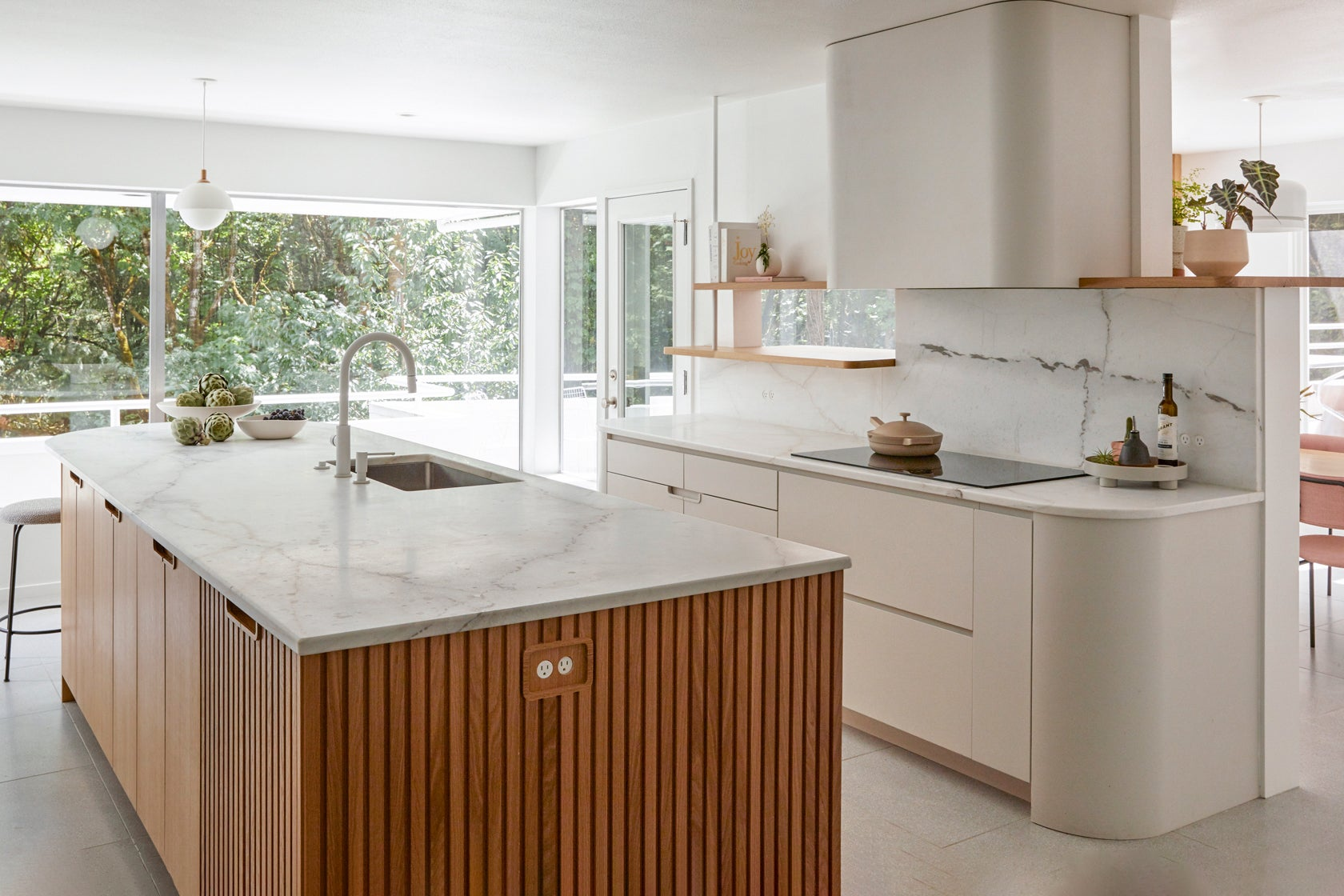 white kitchen with slatted wood island