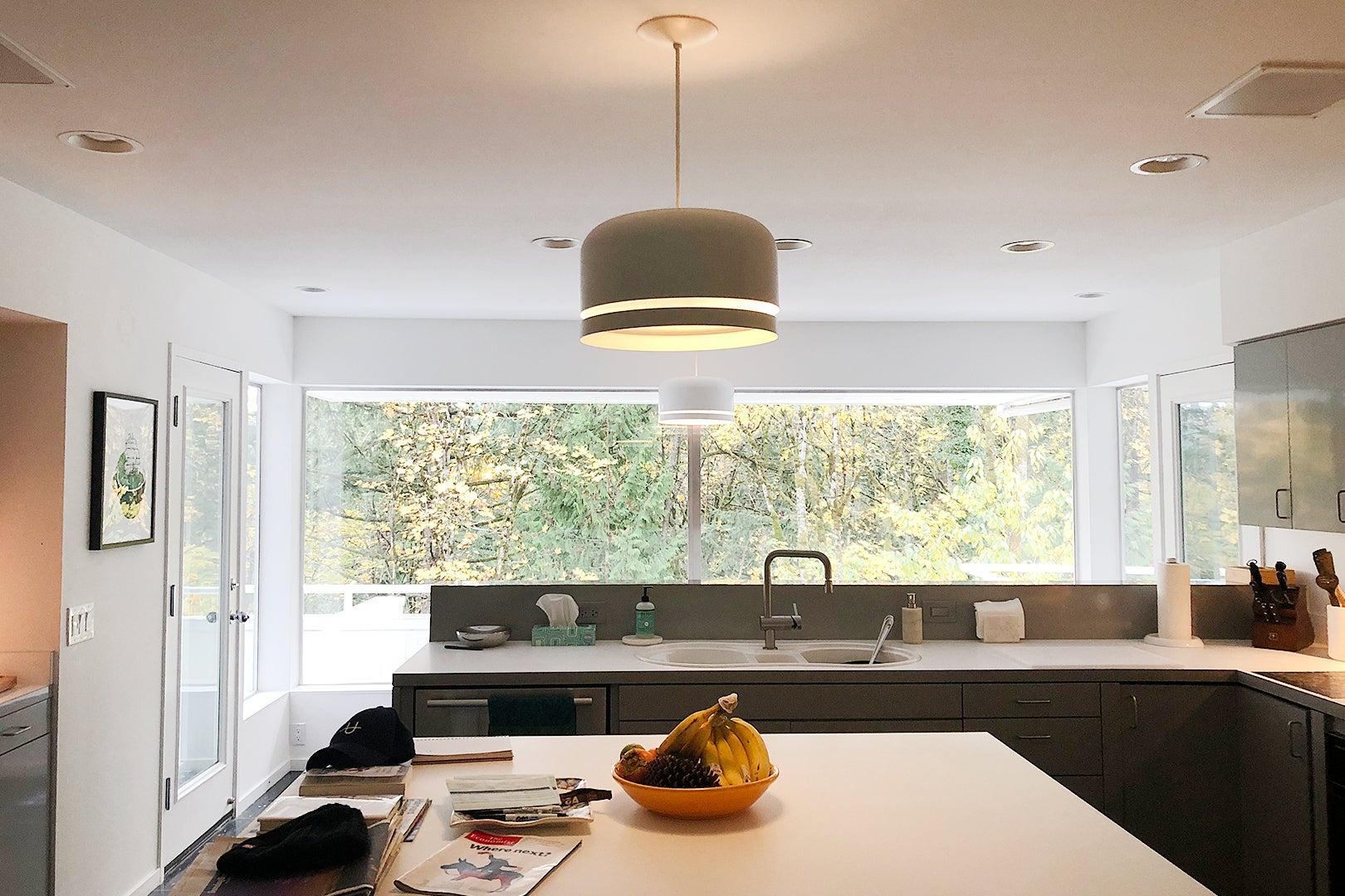 gray kitchen facing windows