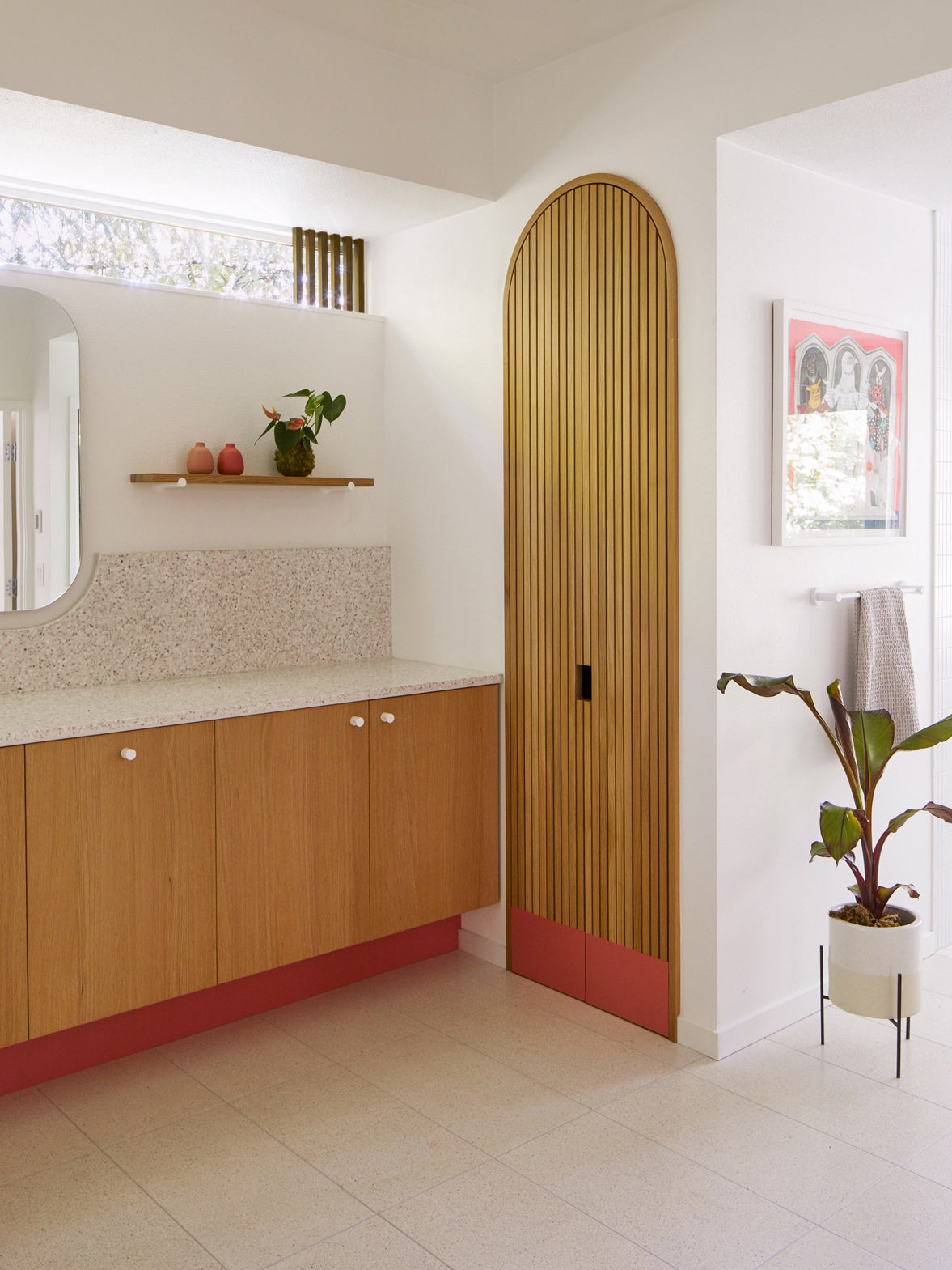 wood slatted door next to wood cabinets with red accents