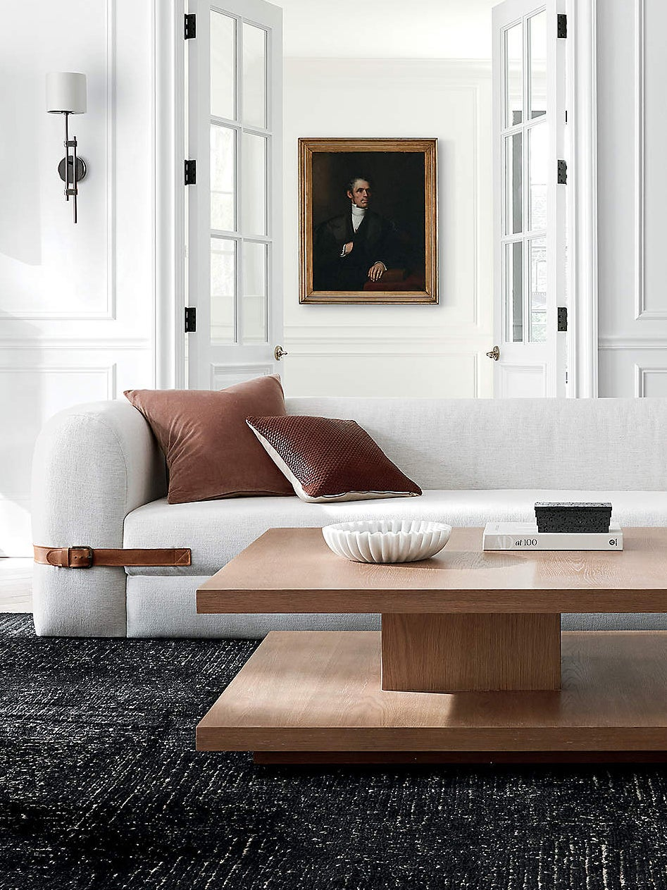 wood table in front of white sofa