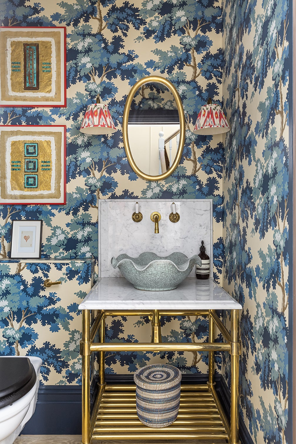 blue wallpapered powder room