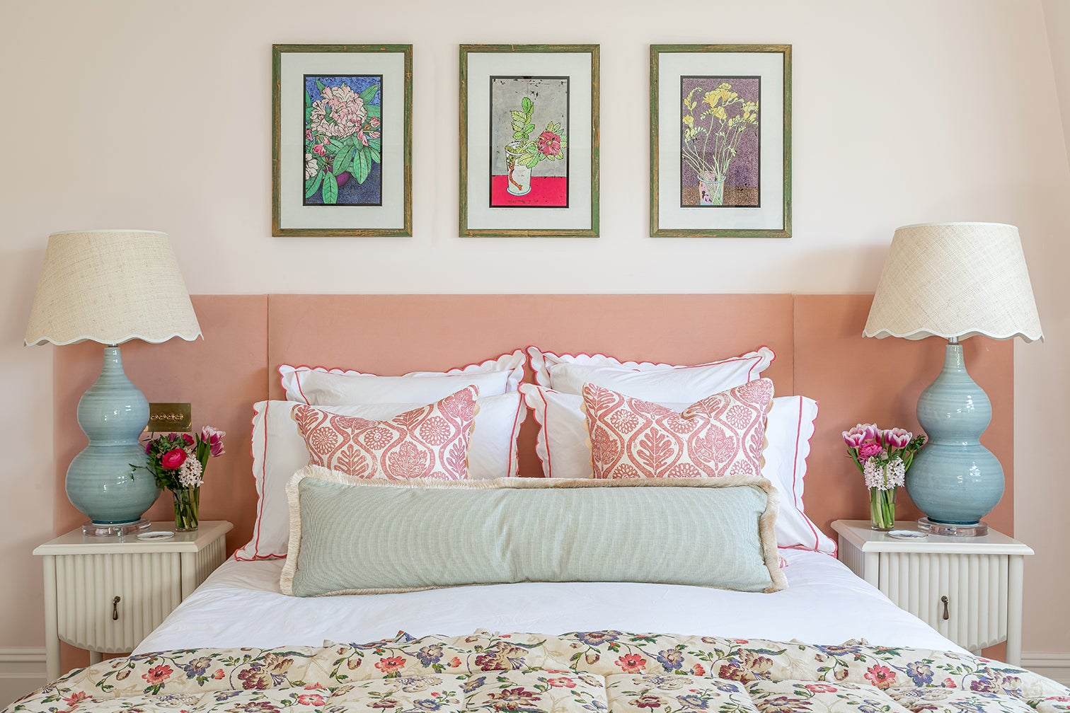 bed with pink upholstered headboard