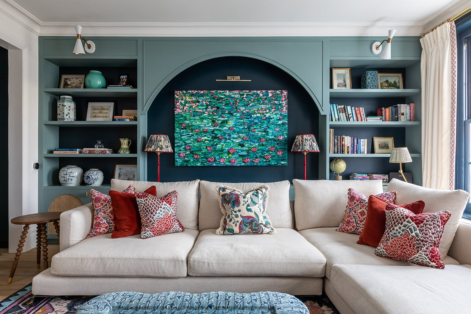 living room with built-in blue bookcases