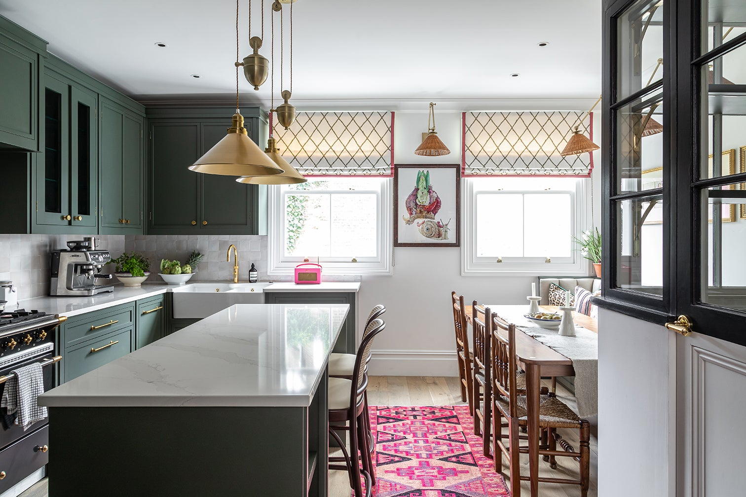 green kitchen with banquette