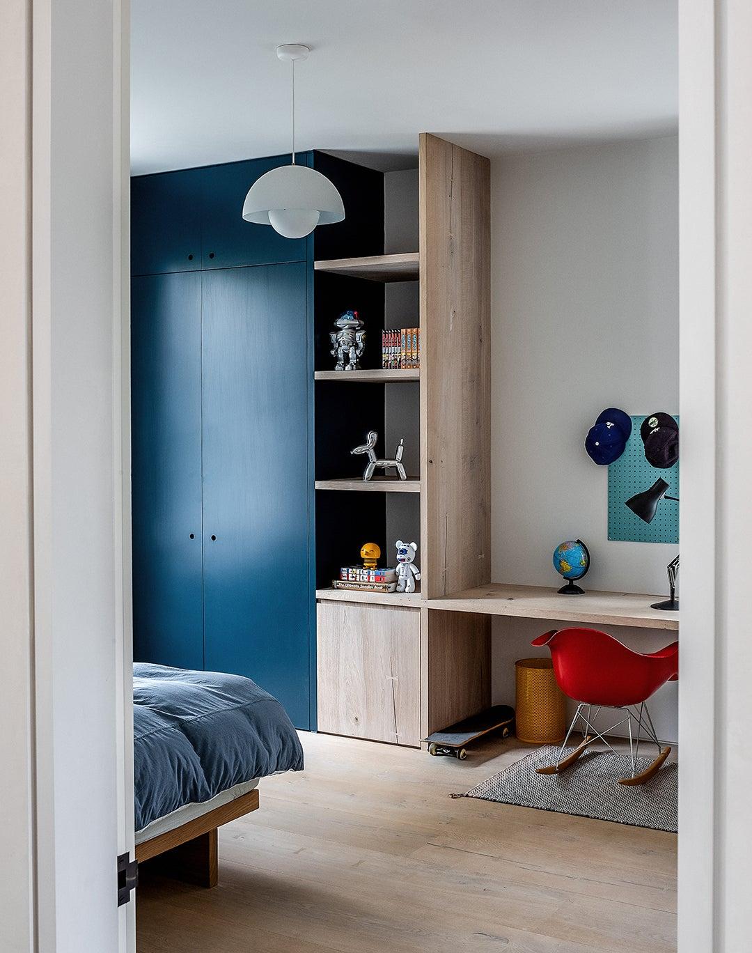 blue built-in cabinet in kids room