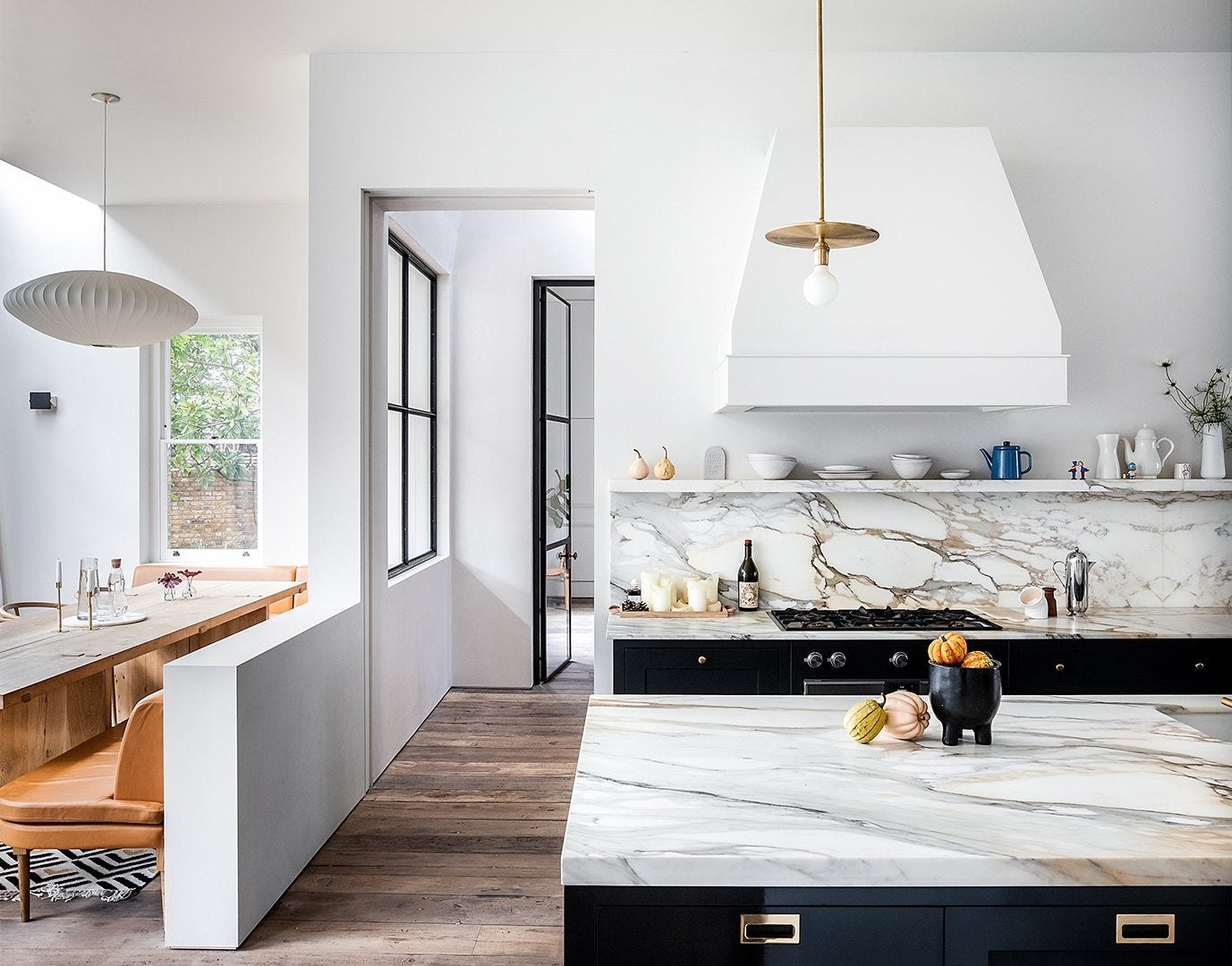 kitchen wiht half wall separating dining area