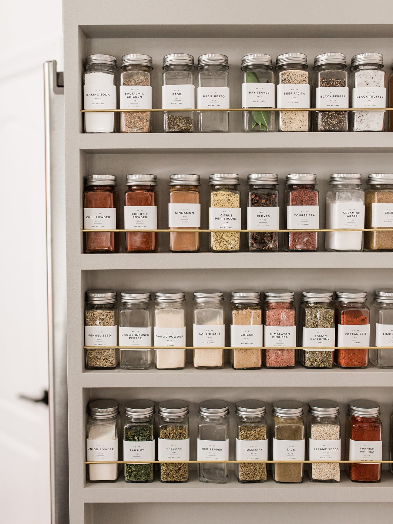 spices lined up on door