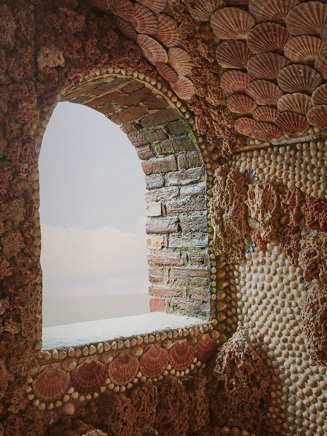 arched window with shellwork