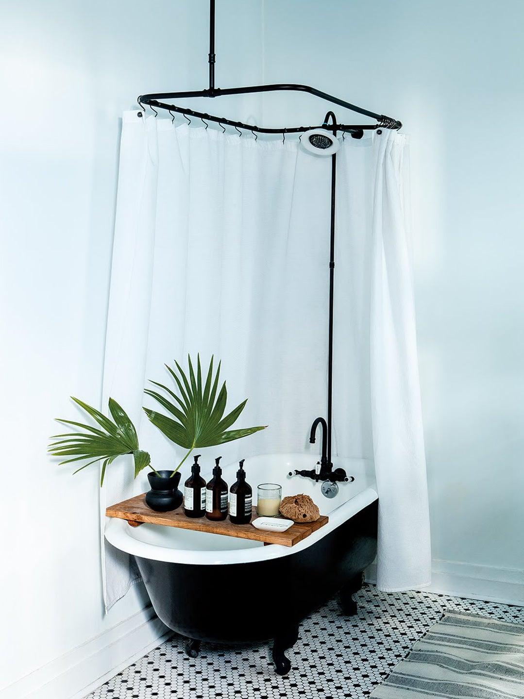 blue bathroom with claw foot tub shower