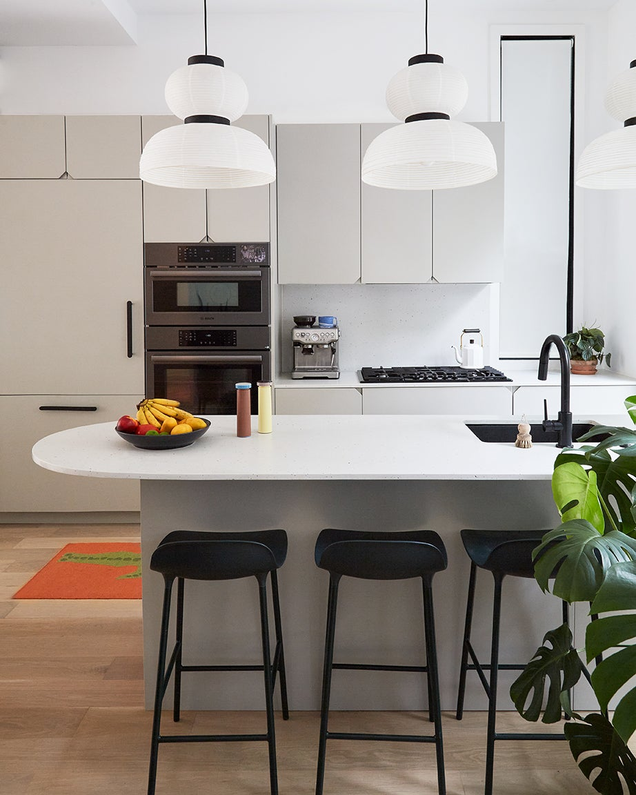 White walls and light gray kitchen cabinetry