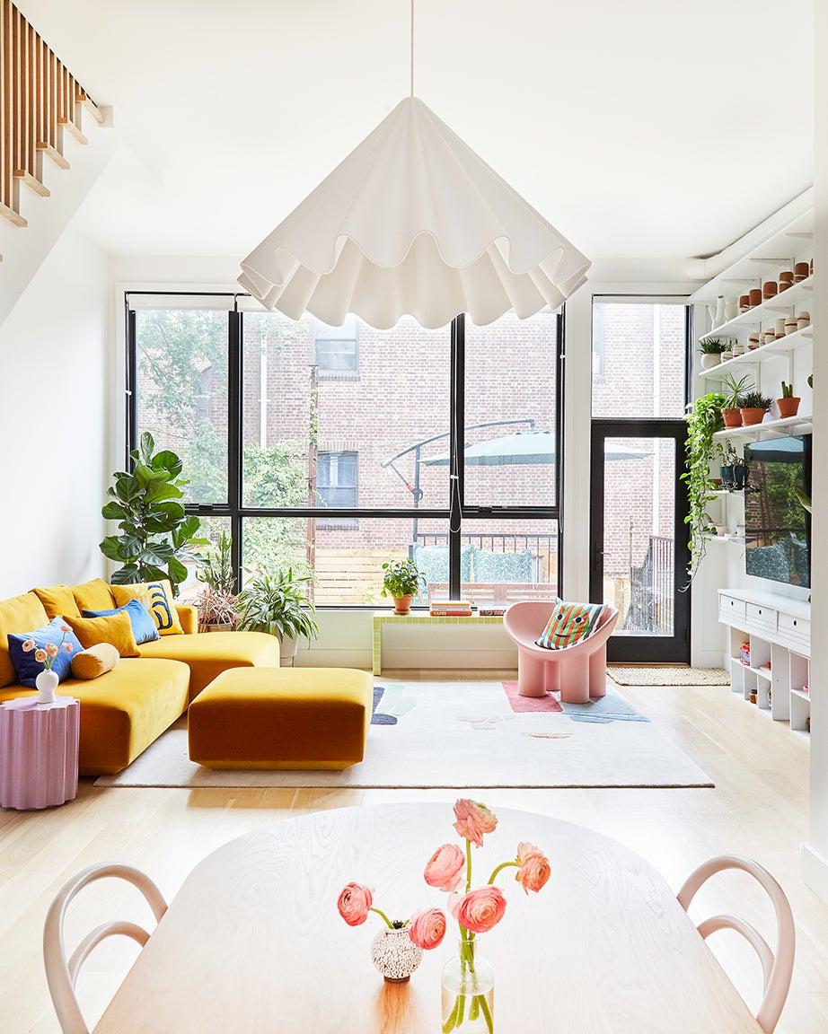 Yellow sofa, white walls and lamp