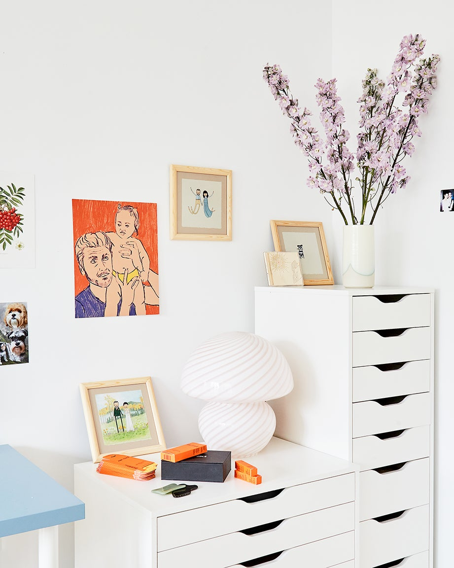 White shelves and walls and paintings