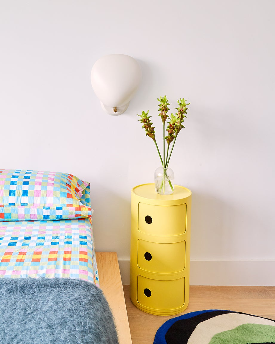 gingham bed sheets and lemon night stand