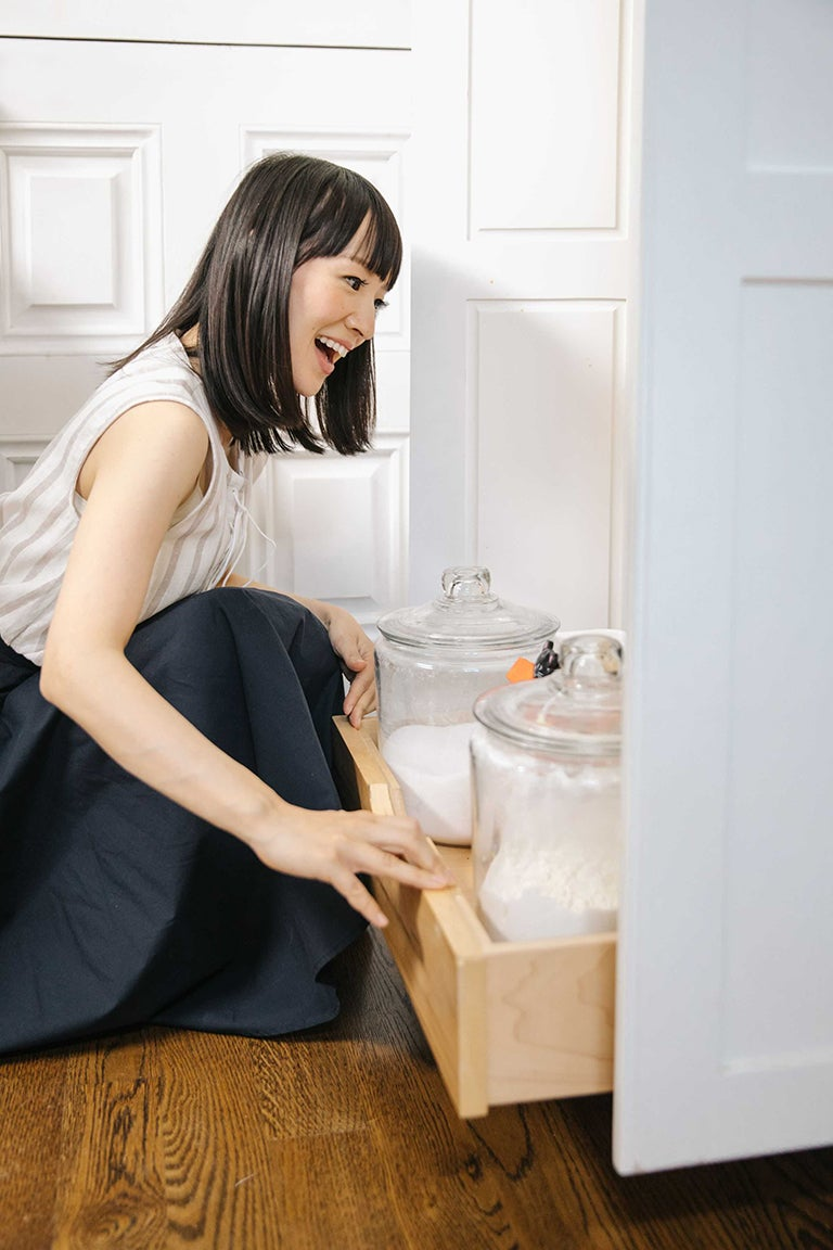 marie kondo pulling out pantry drawer