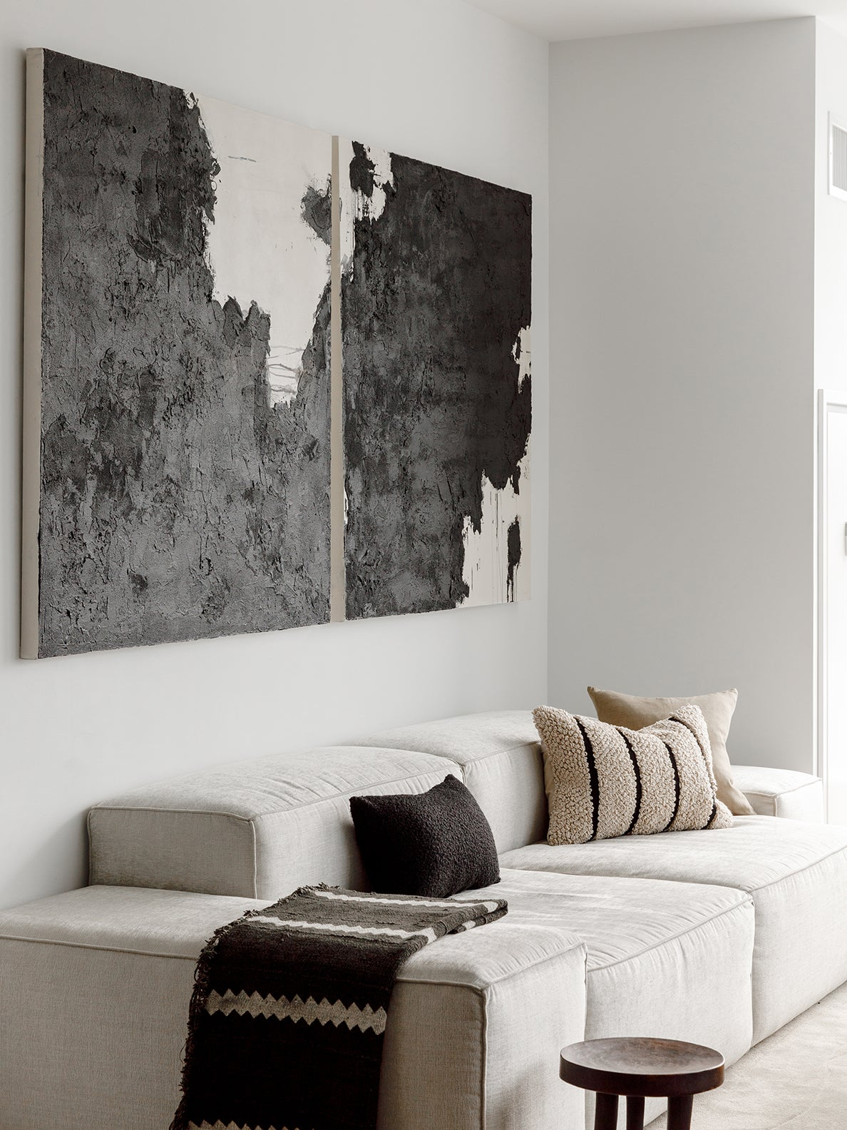 black and white art over sofa