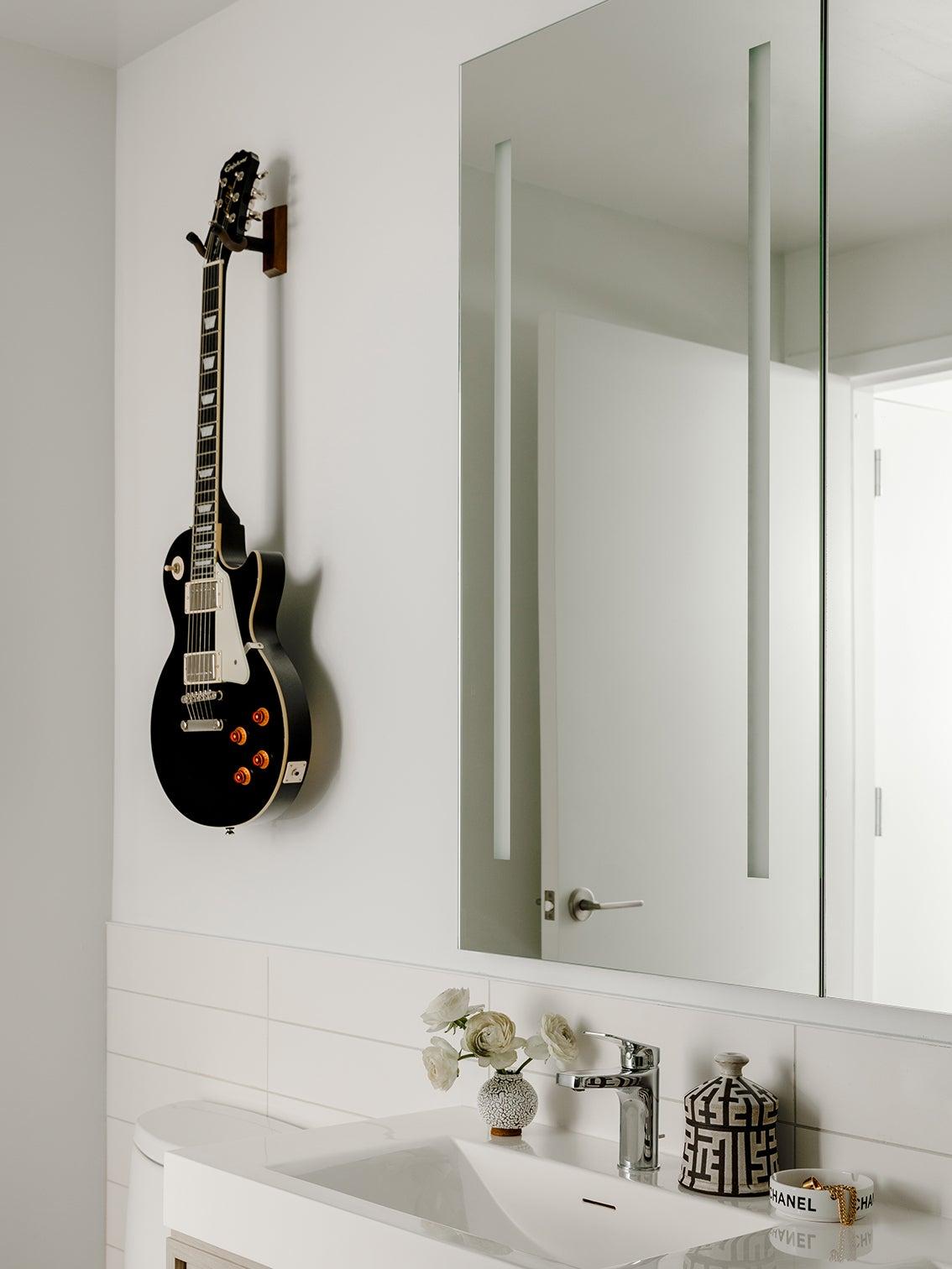 guitar hanging in bathroom
