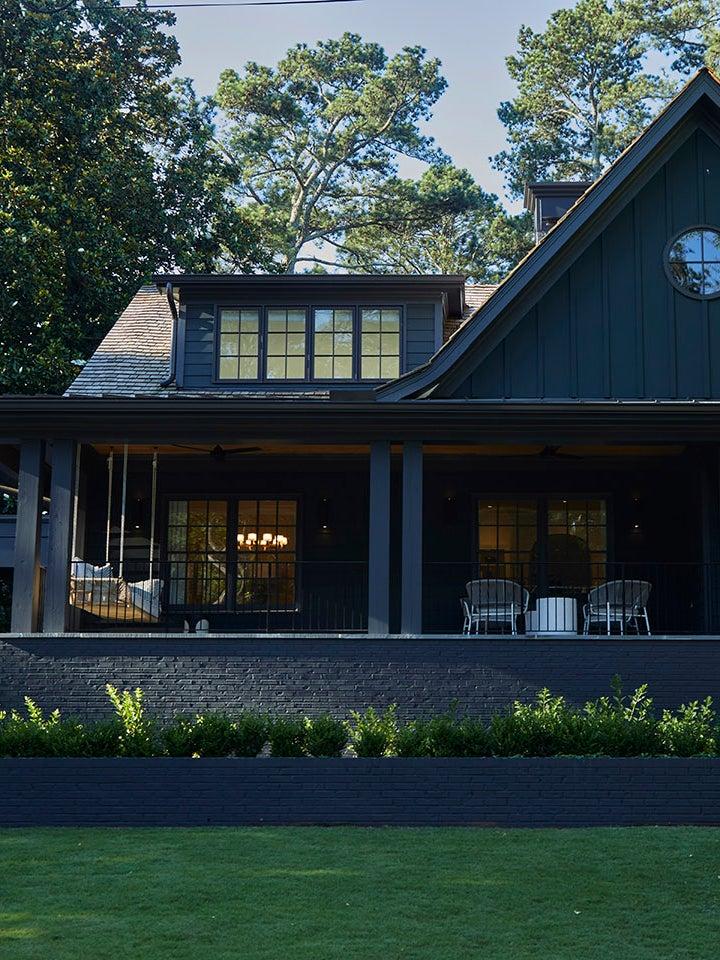 black home exterior with porch