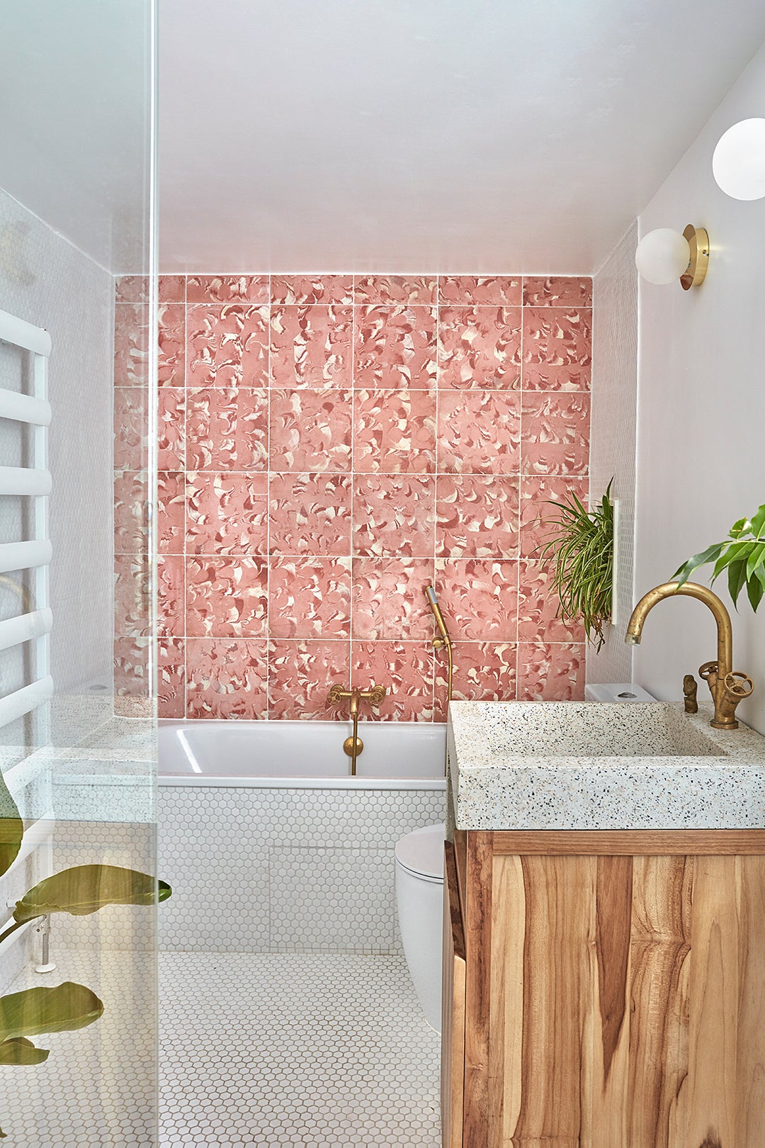 bathroom with swirly pink tile
