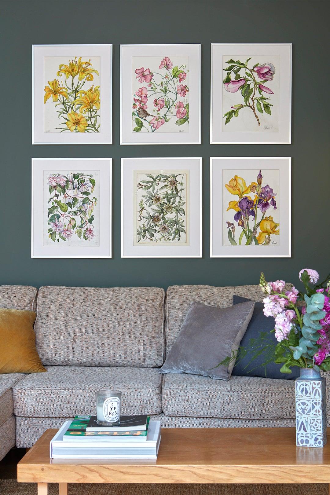 botanical prints on green wall