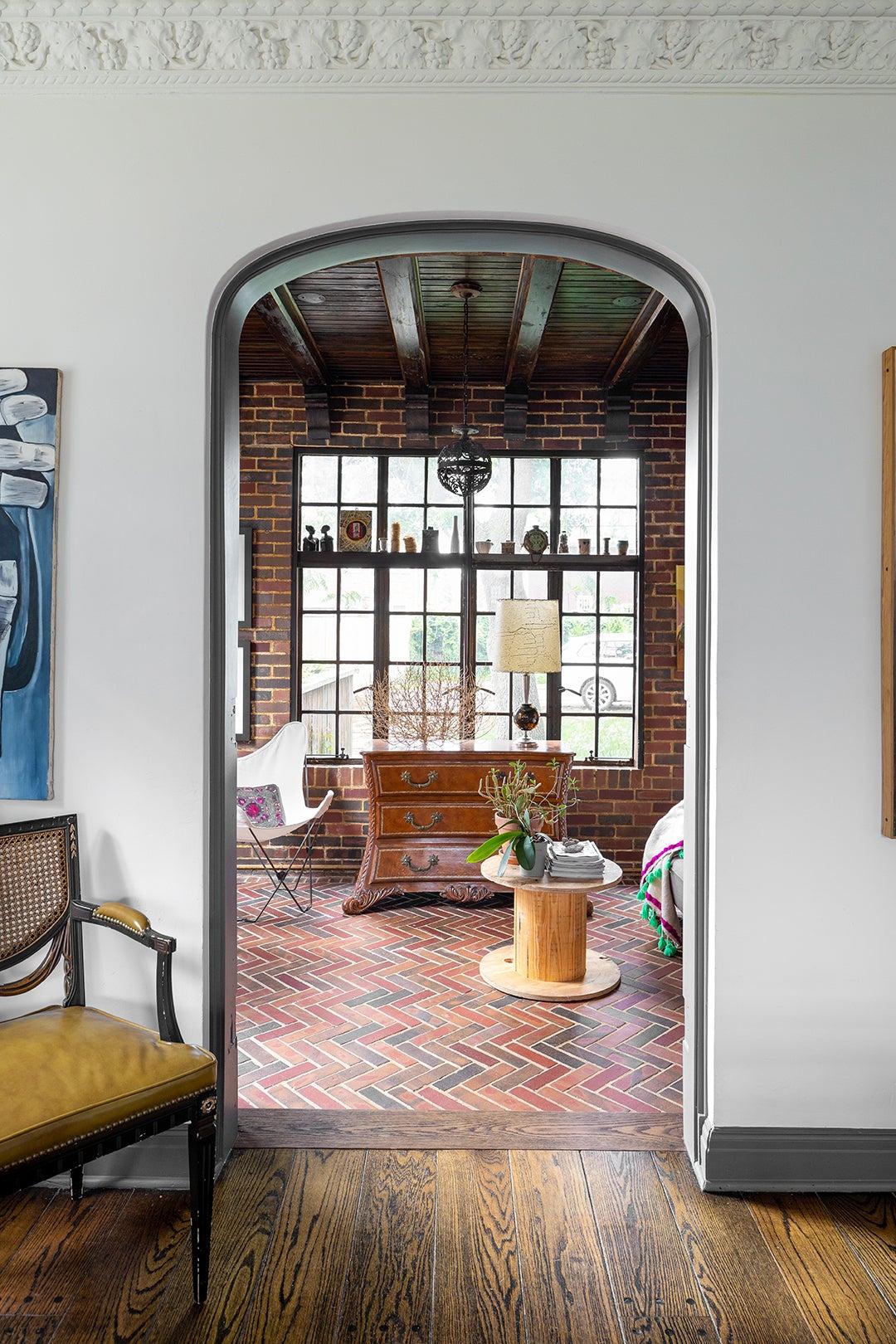 archway looking into brick room