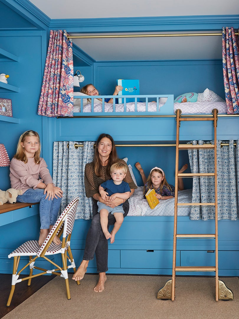 woman holding kid on bunk bed