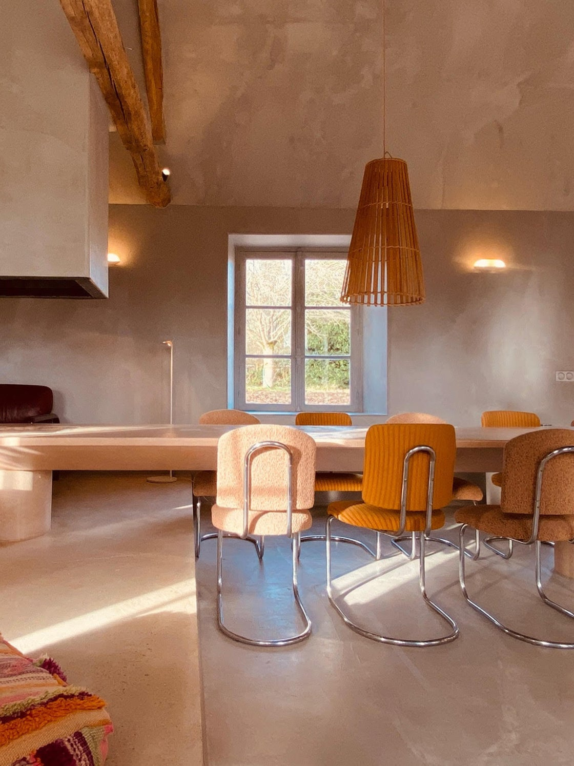 A 16-Foot Pink Concrete Table Connects This French Home's Living and Dining Areas