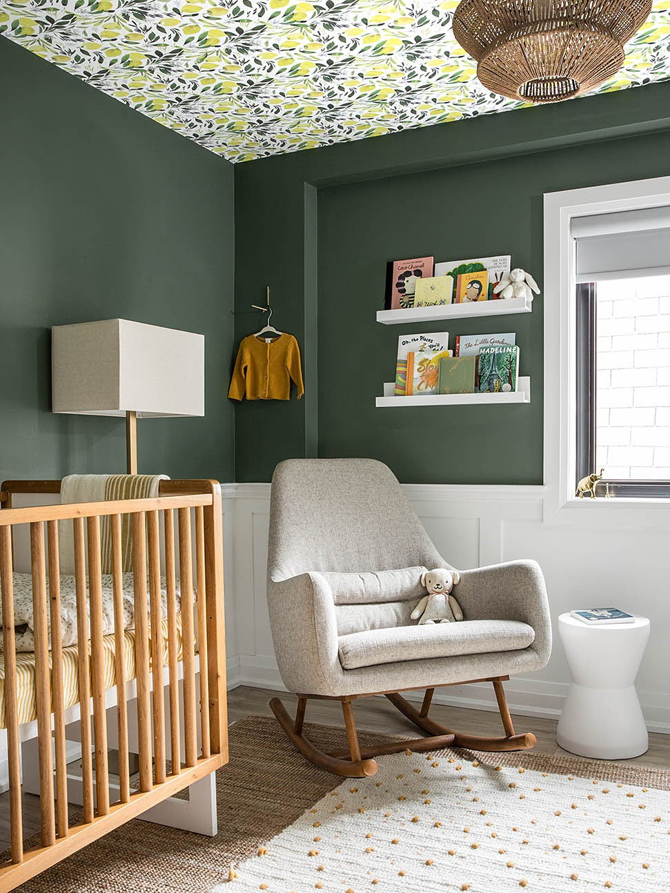 forest green nursery with wallpapered ceiling