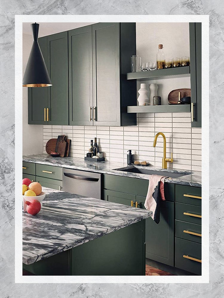 Gold Moen Faucet in Green Kitchen