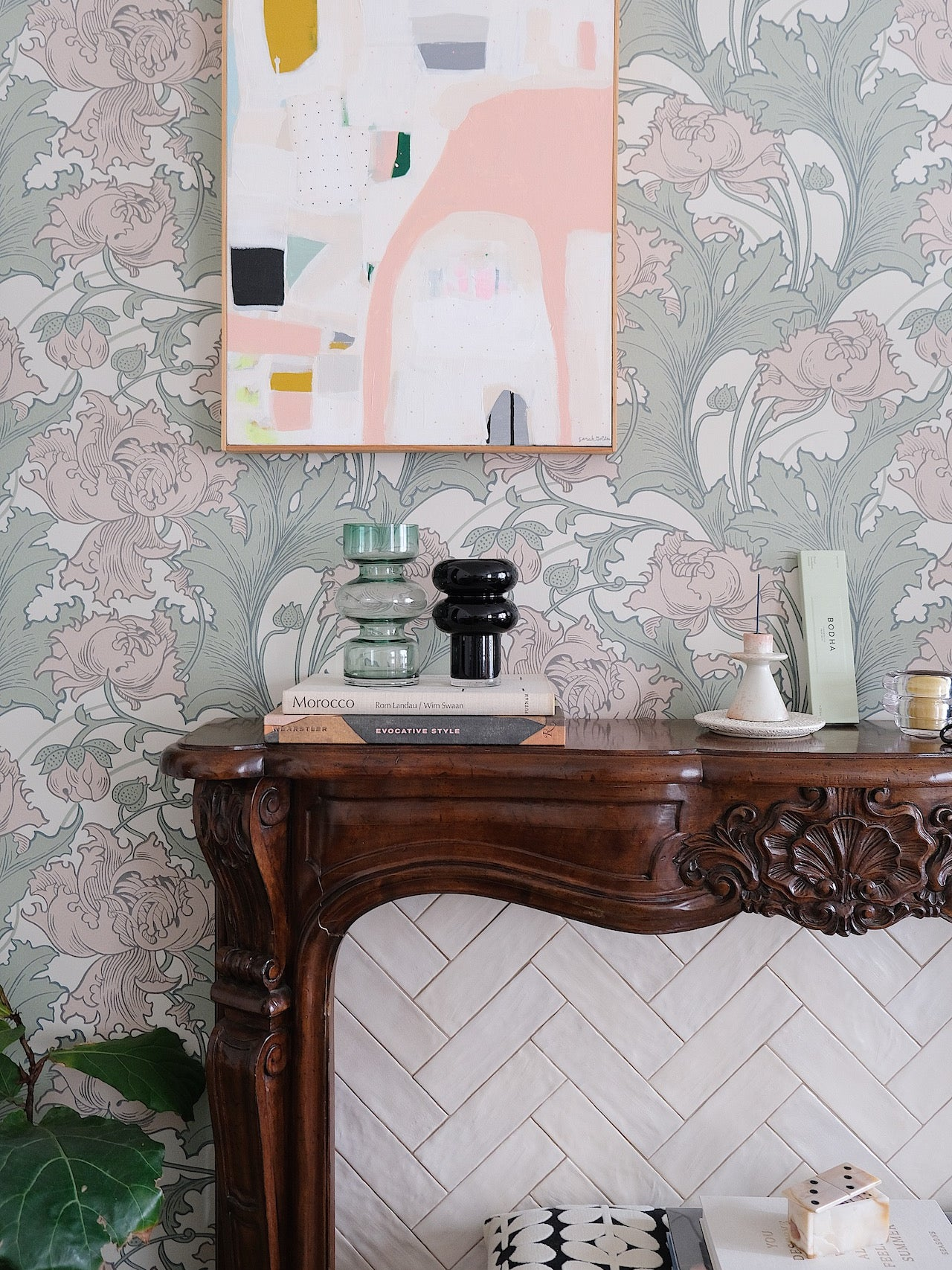 wood mantel with floral wallpaper