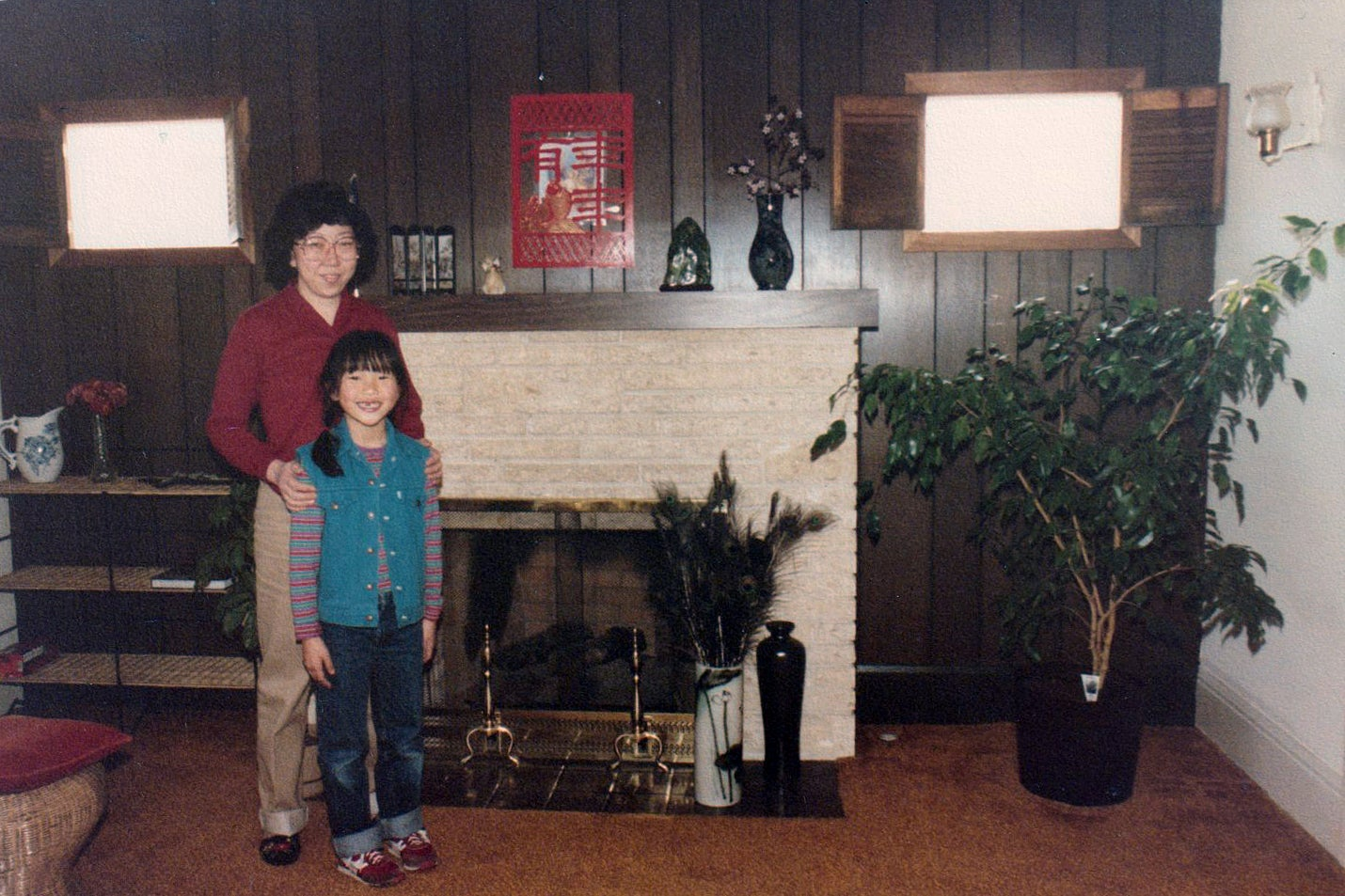 family in front of fireplace