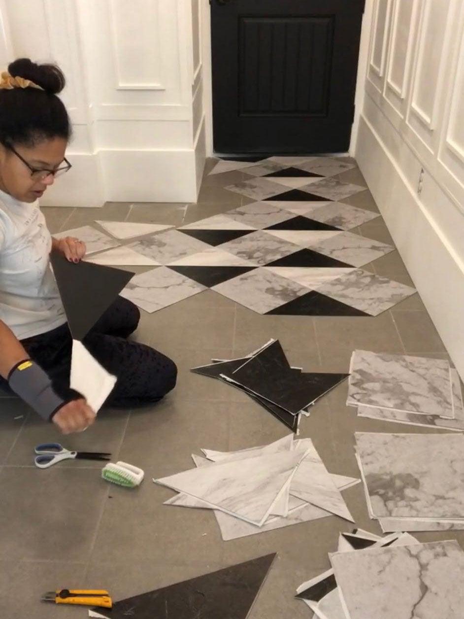 woman applying floor tiles