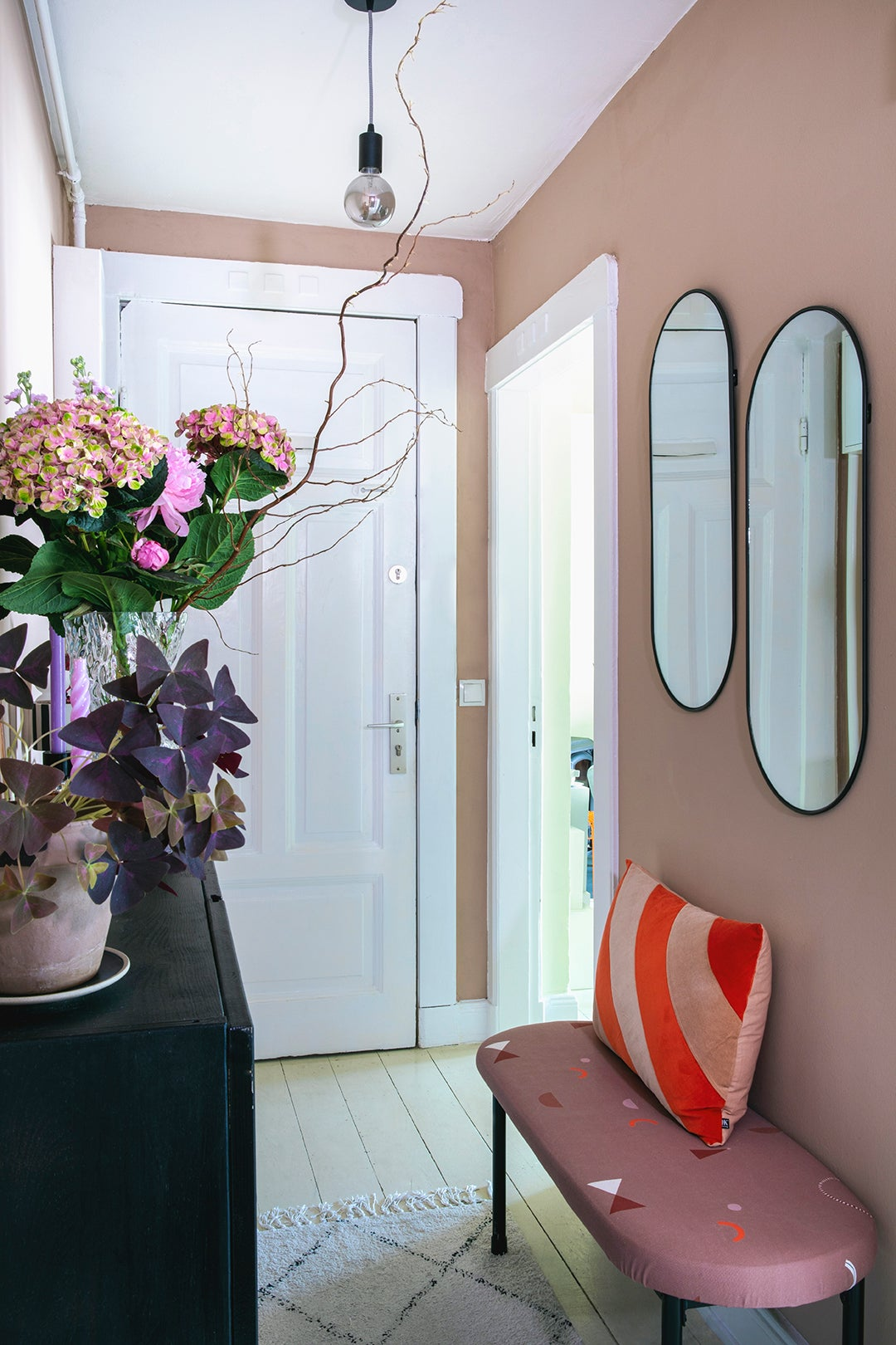entry way with bench and pink walls