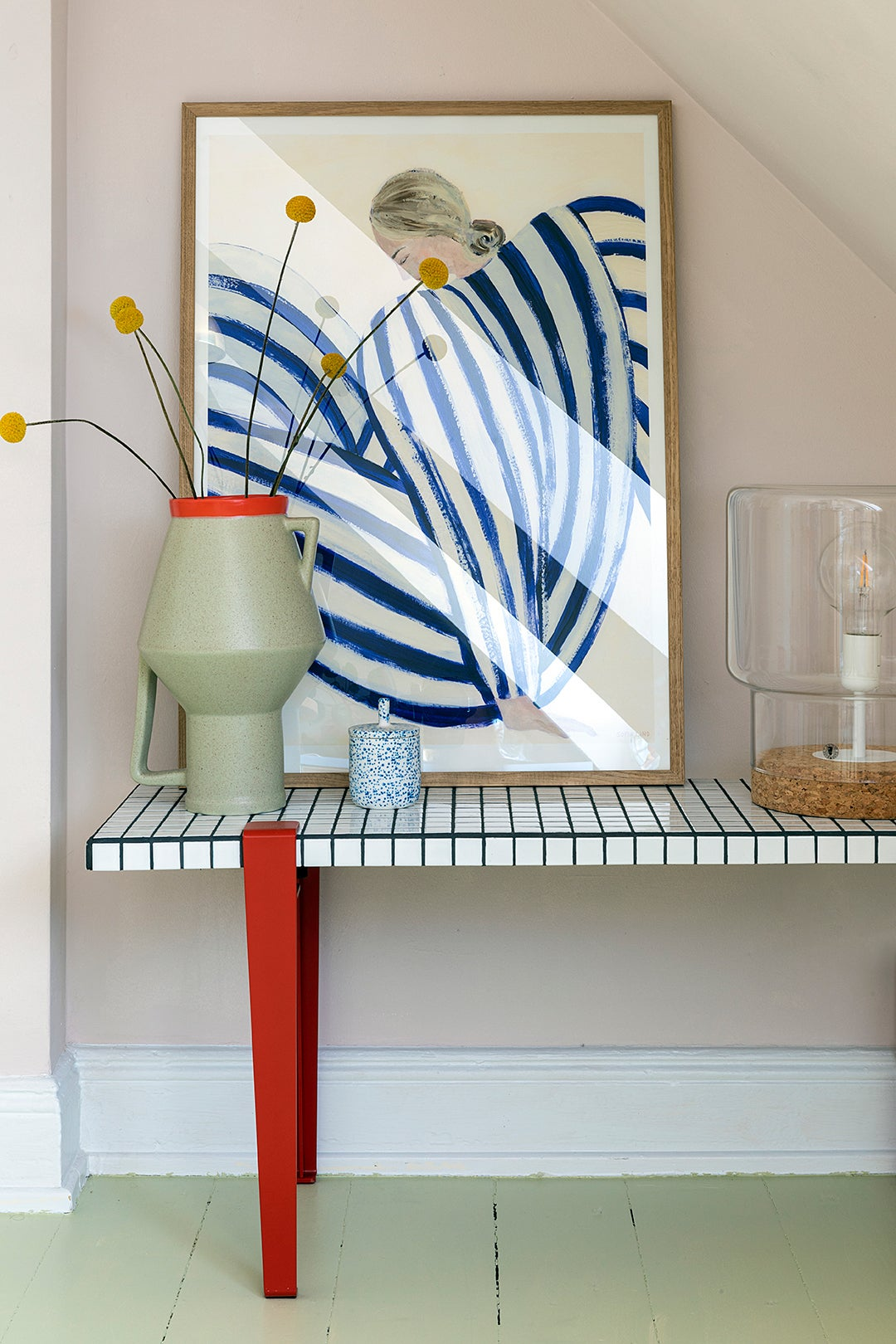 tiled bench with red legs