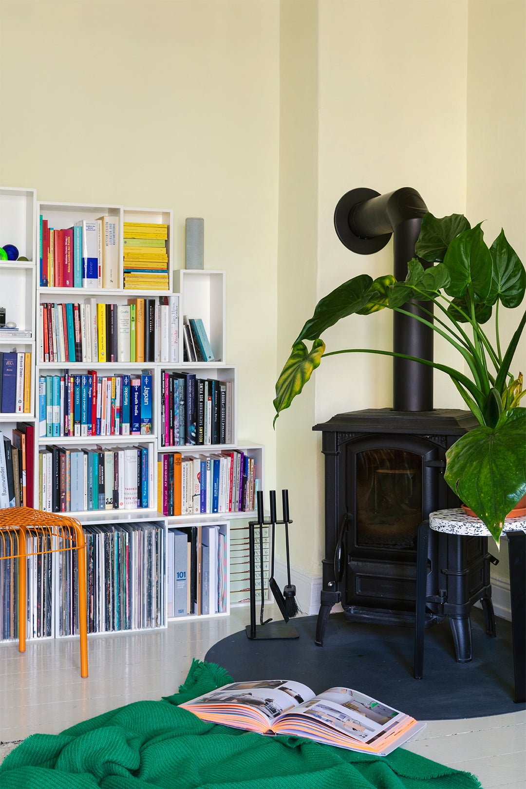 bookcase with black fireplace