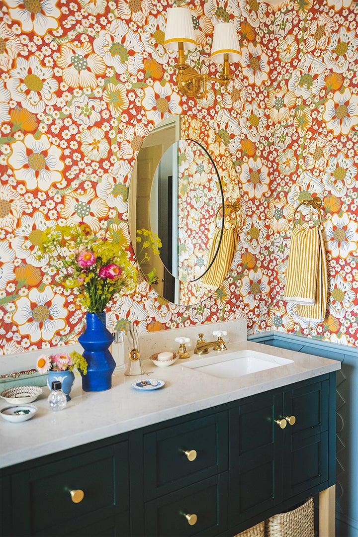 green bathroom vanity with gold mirror