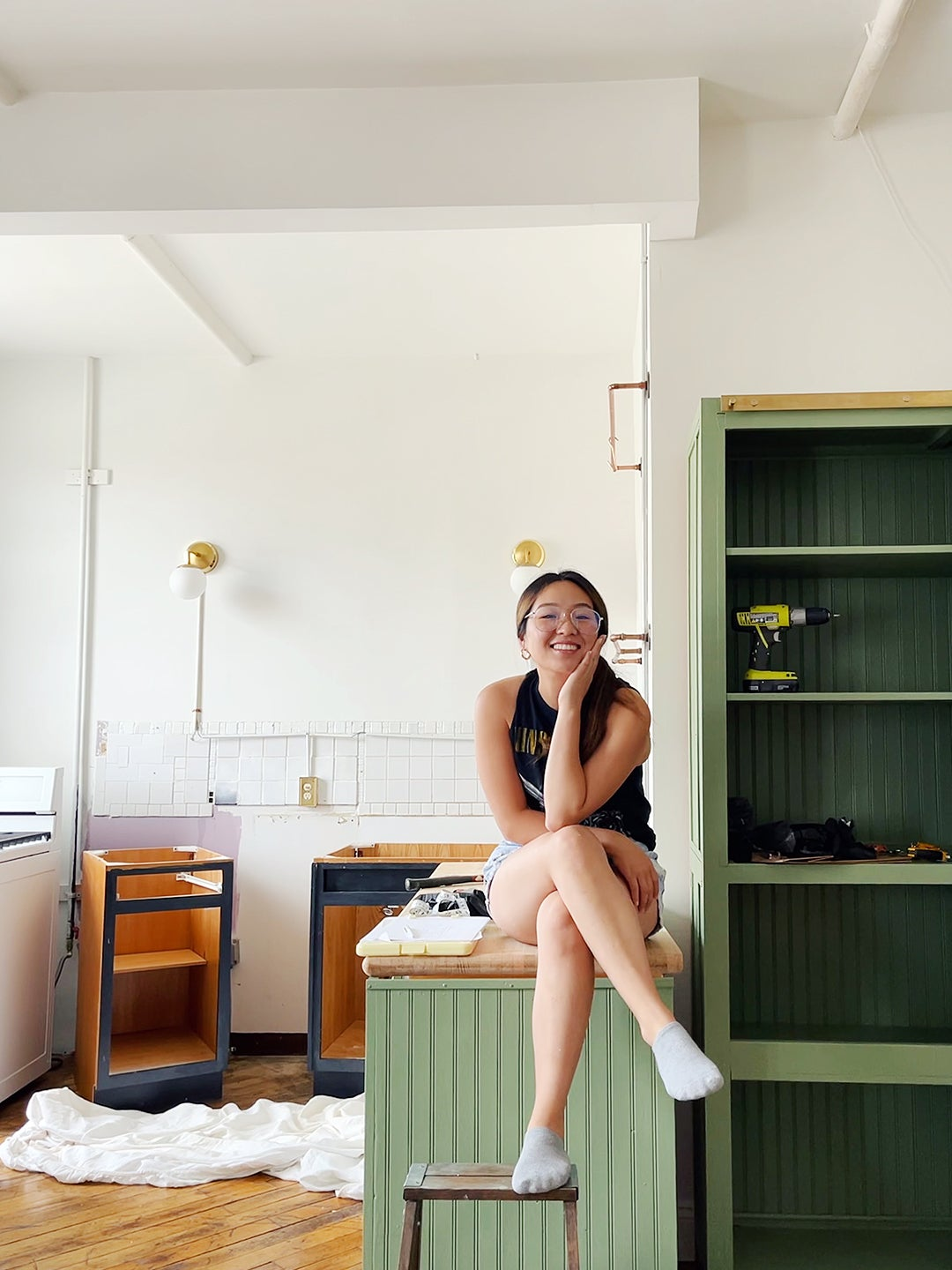 woman sittong on countertop