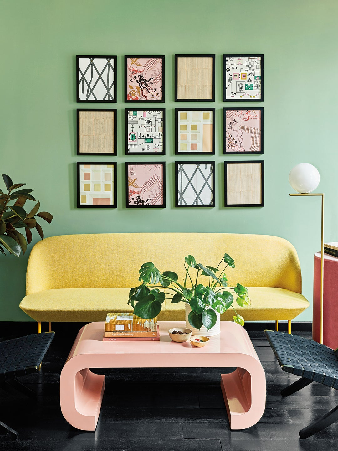 green walls, yellow sofa and pink coffee table
