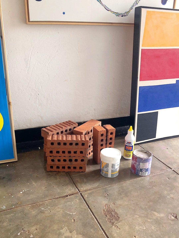 bricks and art materials on ground