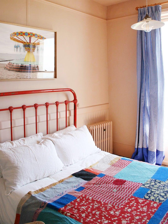 red bed frame in bedroom