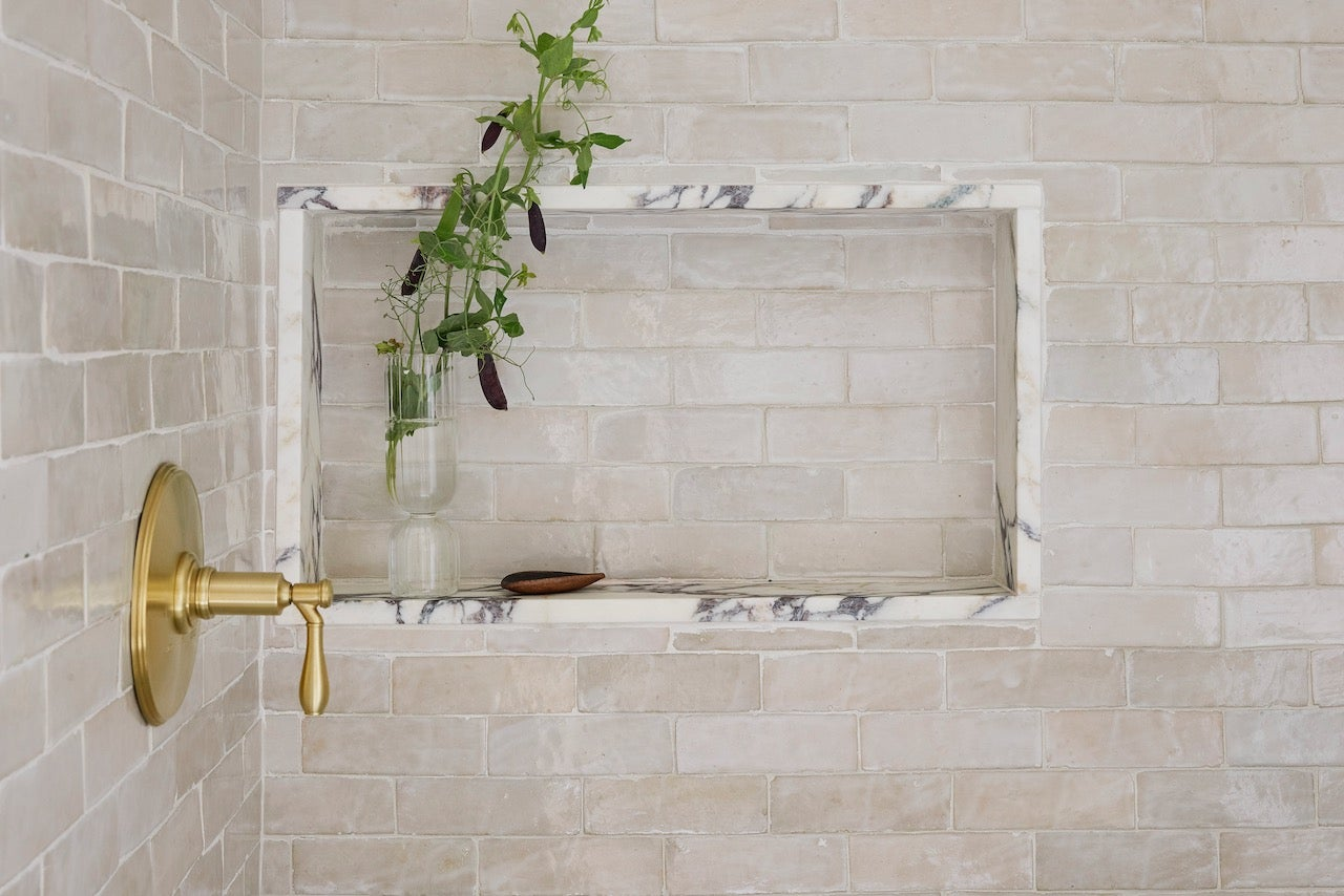 marble lined shower niche