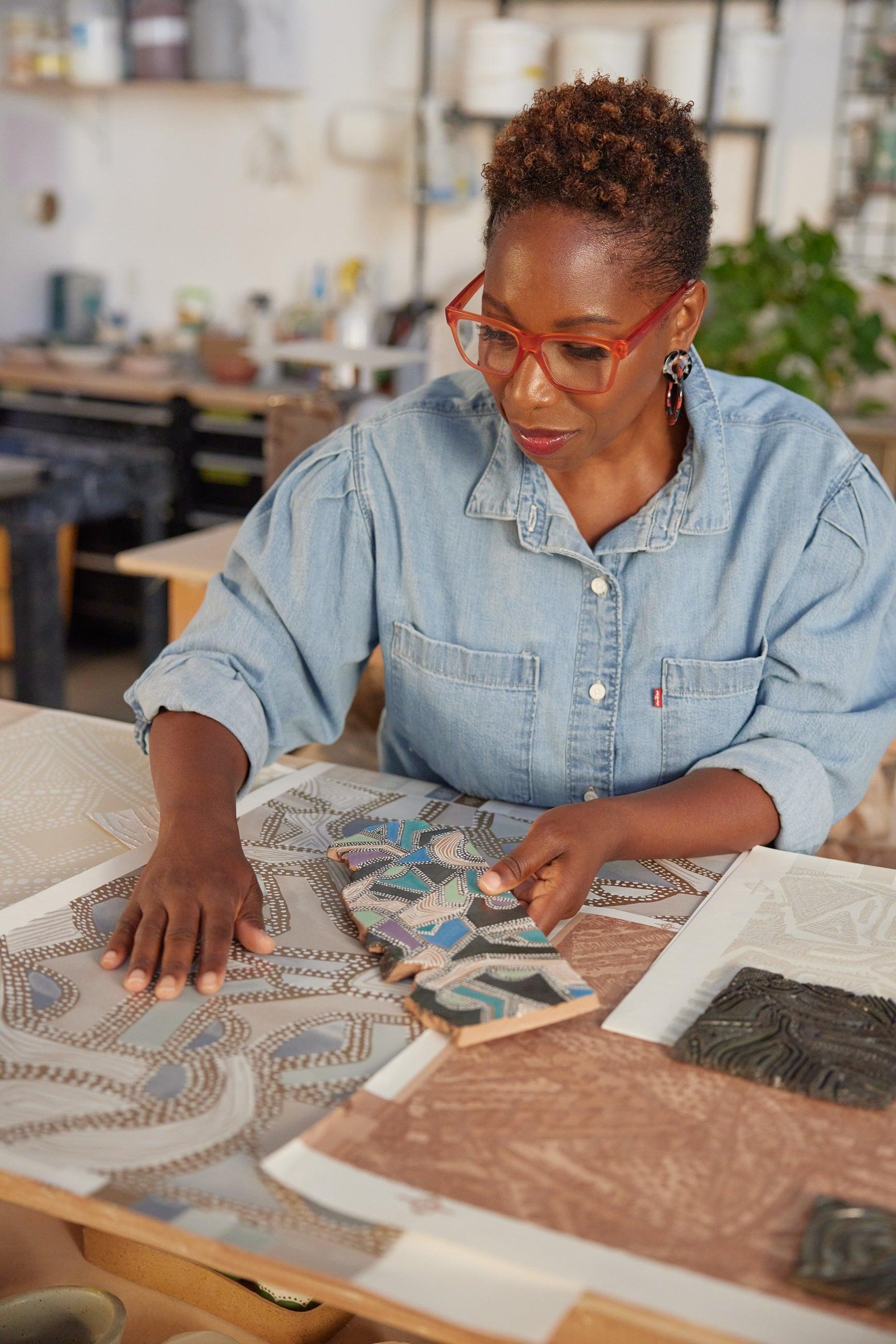artist looking at wallpaper designs