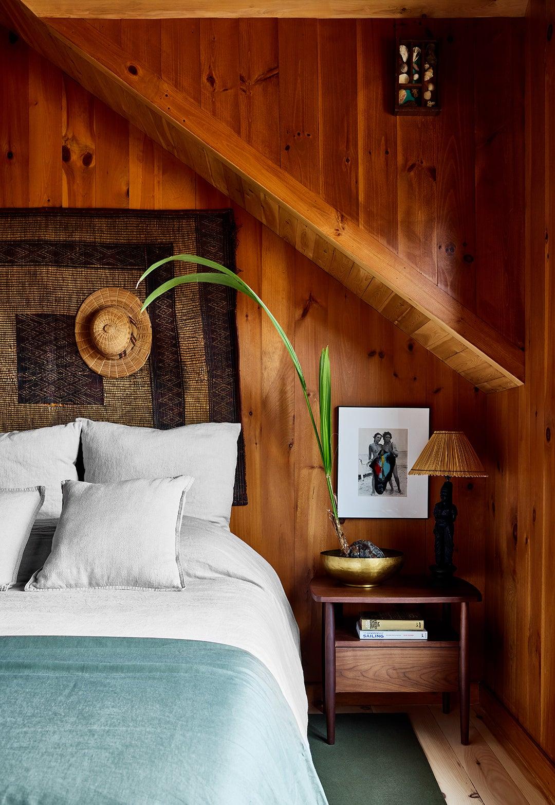 wood paneled bedroom
