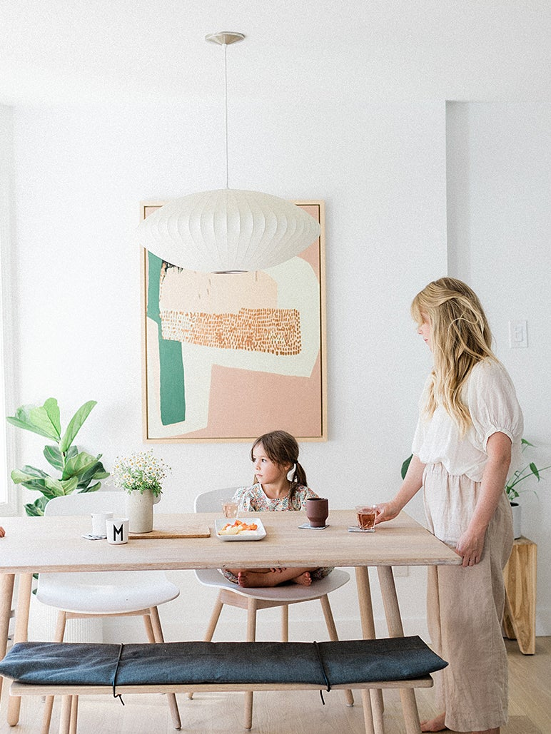 woman and kids at table