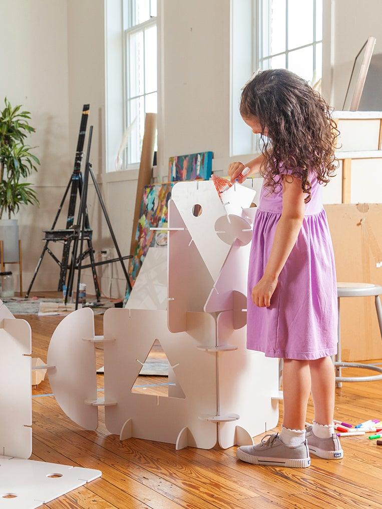 girl building fort